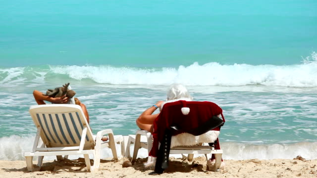 santas beach holiday - funny merry christmas greetings stock videos and b-roll footage