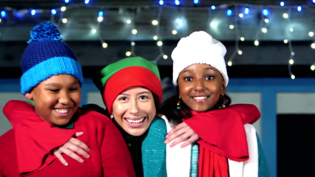 santa's elf puts arms around two children - woolly hat stock videos & royalty-free footage