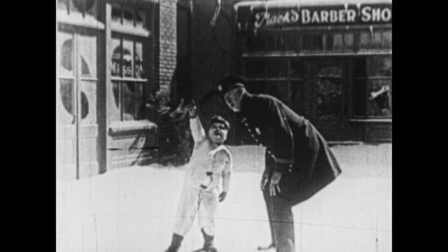 1926 santa's gift allows a pair of pants to escape from the apartment - 1926 stock-videos und b-roll-filmmaterial