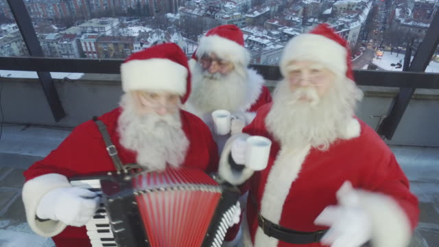 santa's roof party - three quarter length stock videos & royalty-free footage