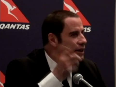 stockvideo's en b-roll-footage met victor marti us actor and licensed airplane pilot john travolta was his usual personable self while wooing journalists at a press conference in chile... - us airways