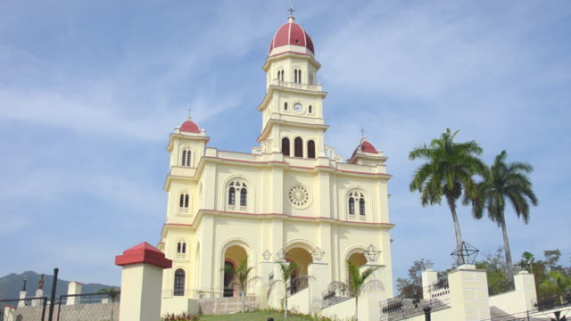 ws pan santiago cuba famous church called basilica el cobre containing virgin mary medal with steeple and green grass on sunny day most important cuban church / santiago,  cuba - santiago de cuba stock videos and b-roll footage