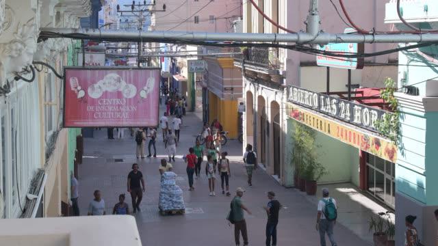 santiago de cuba, cuba-march 20, 2020: high angle view and establishing shot of the 'las enramadas' boulevard or pedestrian walkway in the downtown... - local landmark stock videos & royalty-free footage