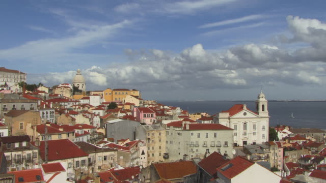 HA WS Santo Estevao Church and cityscape with dome of National Pantheon in background / Lisbon, Portugal