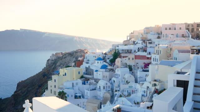 santorini at oia city greece with sunrise, 4k resolution - oia santorini stock videos & royalty-free footage