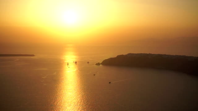 santorini golden sunset with boats and oia village - oia santorini stock videos & royalty-free footage