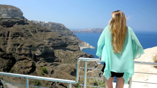 Santorini landscape & woman on terrace