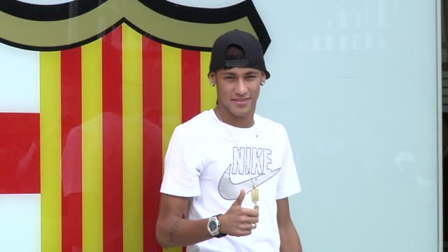 santos and brazil star neymar was all smiles on monday as barcelona presented him as the latest addition to the club after the 21 year old star whose... - neymar da silva stock-videos und b-roll-filmmaterial