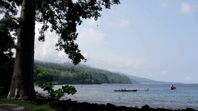 sao tomé and principe, sao tomé island, lagoa azul, fishermen with their traditional boats dug in a single trunk - azul stock-videos und b-roll-filmmaterial