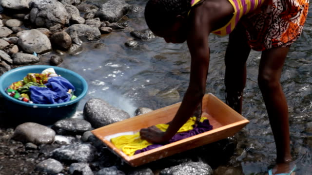 Sao Tomé and Principe, Sao Tomé island, Neves, woman washing clothes in the river