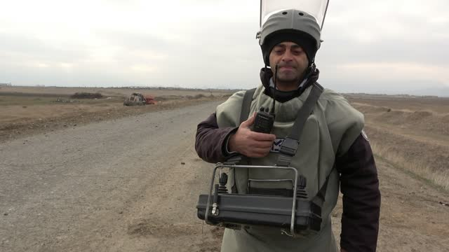 sapper of the azerbaijan national agency for mine action wearing a bomb suit prepares to operate an unmanned mine clearing vehicle device near the... - 14 15 years stock videos & royalty-free footage