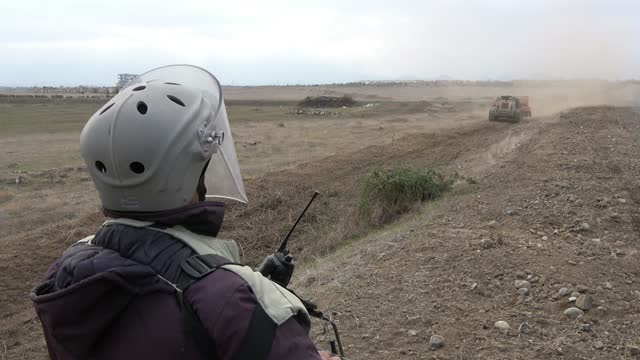 sapper of the azerbaijan national agency for mine action wearing a bomb suit operates an unmanned mine clearing vehicle device near the town of agdam... - 14 15 years stock videos & royalty-free footage