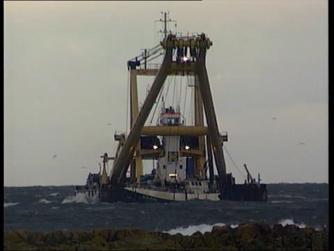 Bodies recovered ITN SCOTLAND Peterhead Dutch crane barge Tak Lift 7 leaving port as takes trawler Sapphire back out to sea to be returned to the sea...