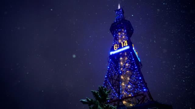 sapporo tv tower in snow winter in hokkaido, japan - hokkaido stock videos & royalty-free footage