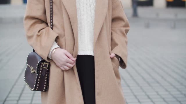 sara carnicella, fashion blogger from la fille rebelle, wears a zara beige coat, a zara white pull over, a zara black skirt, zara black thigh high... - thigh stock videos & royalty-free footage