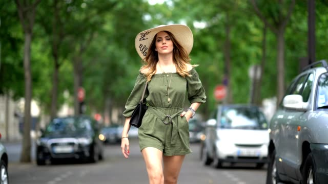 sara carnicella fashion blogger wears a forever 21 hat a zara green khaki off shoulder dress suit a valentino bag and valentino heels shoes on june... - shoulder bag stock videos & royalty-free footage