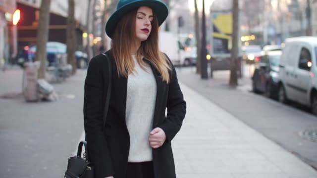 Sara Carnicella from the blog La Fille Rebelle is wearing a Zara hat an HM white pull over a Zara black coat a Zara black skirt Zara thigh high black...