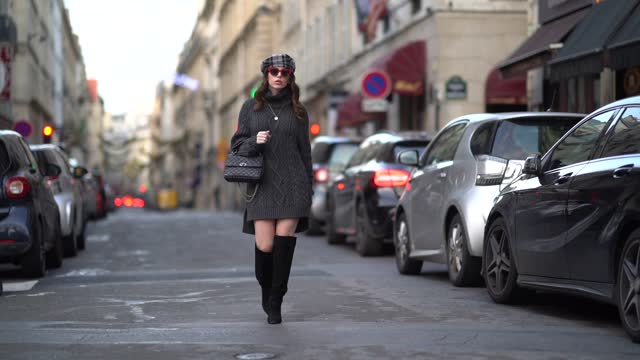 sara carnicella wears a dark gray knitted wool long pullover / dress with turtleneck from parosh, a gray checked beret hat from anthony peto, red... - jumper stock videos & royalty-free footage