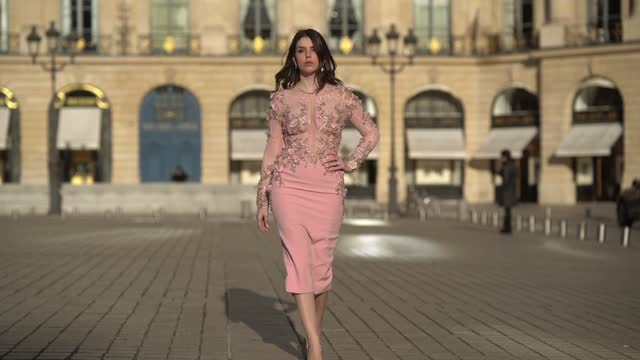 sara carnicella wears a golden necklace, a pink dress with mesh lace and floral embroidery from tony ward, valentino studded high heels pointy shoes,... - dress stock videos & royalty-free footage