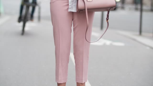 sarah benziane fashion blogger les colonnes de sarah wears a new look white shirt new look pink pants zara white shoes with wooden heels sunglasses... - pink shirt stock videos and b-roll footage