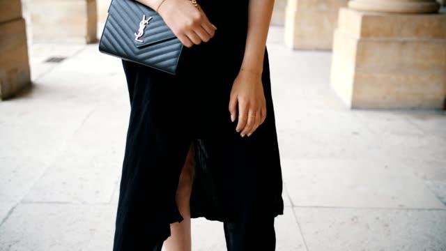 sarah benziane fashion blogger les colonnes de sarah wears an irl black dress zara shoes and a ysl saint laurent bag on may 6 2017 in paris france - black dress stock videos & royalty-free footage