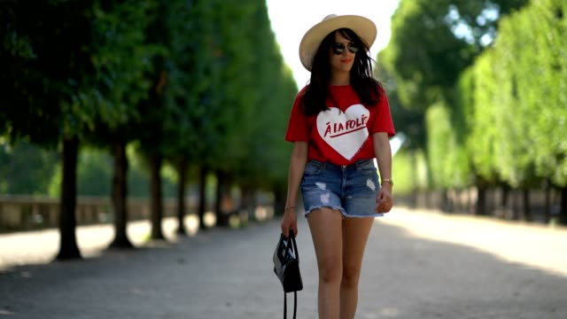 Sarah Benziane fashion blogger wears a Naive New Beater red tshirt with the printed inscription 'A La Folie' and a printed heart a Pimkie blue denim...