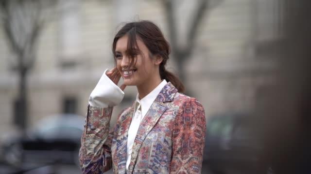 stockvideo's en b-roll-footage met sarah ellen wears a white shirt, a multi color print pattern blazer jacket and suit, outside miu miu, during paris fashion week womenswear... - blazer
