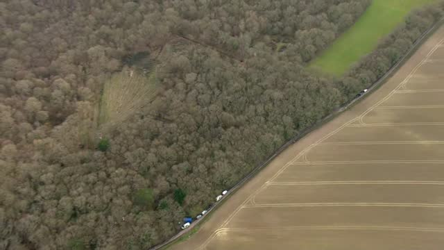air views of police searches in ashford, dover and deal; england: kent: near ashford: ext air views / aerials police searching woodland area with... - driving range stock videos & royalty-free footage