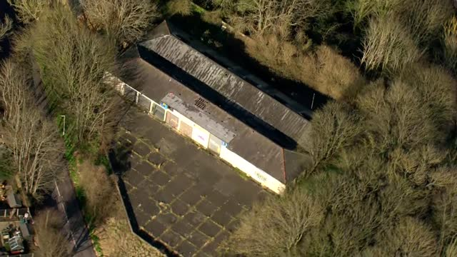 air views of police searches in ashford, dover and deal; england: kent: dover: ext air views / aerials dilapidated garage - run down stock videos & royalty-free footage