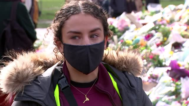 mps debate new policing bill as vigil held outside parliament; england: london: clapham common: ext various of women leaving flowers at memorial for... - discussion stock videos & royalty-free footage