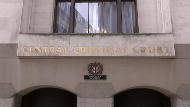 provisional trial date set for october; england: london: central criminal court : ext tilt down court windows and sign above entrance - crime and murder stock-videos und b-roll-filmmaterial