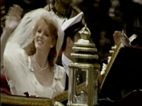 Sarah Ferguson and Prince Andrew Duke of York waving to the crowds as they ride along in a carriage on the day of their wedding day Sarah Ferguson...