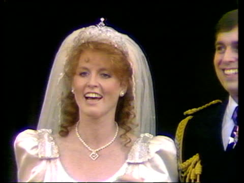 Sarah Ferguson and Prince Andrew kiss on the balcony of Buckingham Palace on their royal wedding day