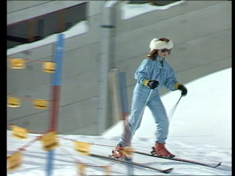 sarah ferguson backgrounder itn lib klosters ms sarah wearing light blue ski suit white fur headband skiing down slope lr cms sarah pull out as... - headband stock videos and b-roll footage