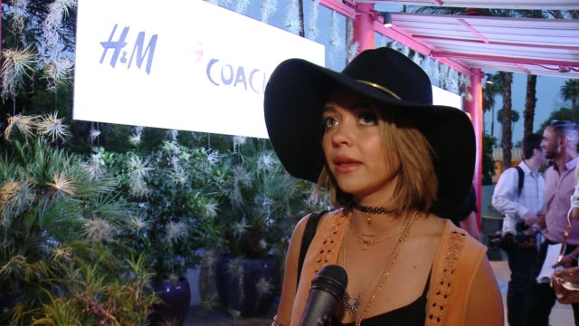 INTERVIEW Sarah Hyland on what brings her out to the festival her first HM experience what makes the new line so great and her goto fashion choices...