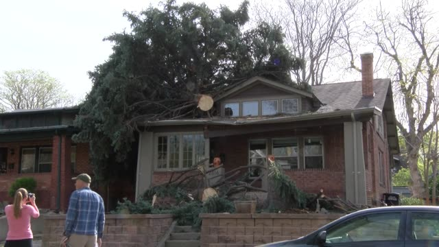 Sarah Jeske and her family were out of town Sunday and returned to find extensive damage to her house from a blue spruce that snapped and fell on the...