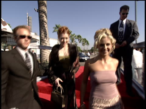 Sarah Michelle Gellar and Alyson Hannigan arriving and signing autographs on the 1998 Video Music Awards red carpet