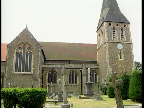 england surrey hersham st peter's church ms tearful mother standing outside church holding child gvs church as voice of reverend nick whitehead heard... - god stock videos & royalty-free footage