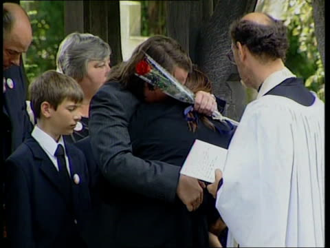 surrey: hersham: michael & sara payne holding each other visibly upset outside church tx 31.8.2000/c5l - other stock videos & royalty-free footage