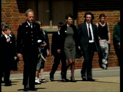 memorial service england surrey guildford ext michael and sara payne along with other family members pan police officers standing outside guildford... - other stock videos & royalty-free footage