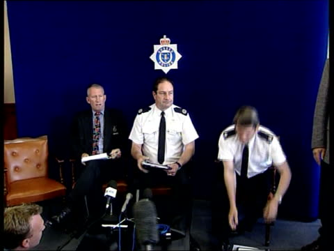 shoe found england west sussex littlehampton int senior police officers sitting down in chairs for press conference including assistant chief... - dress shoe stock videos and b-roll footage