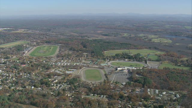 aerial saratoga race track grounds / saratoga springs, new york, united states - pferderennen stock-videos und b-roll-filmmaterial