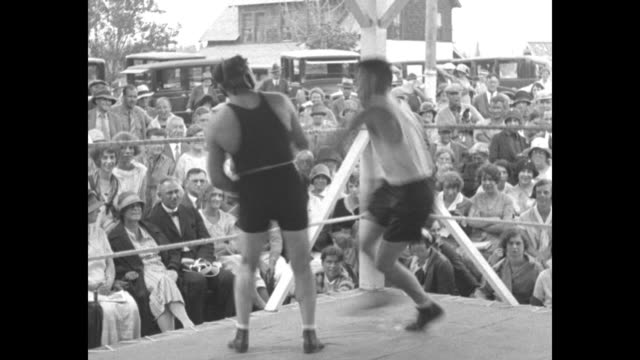 [saratoga springs, ny] vs jack dempsey flexes his back and punches the speedbag; wearing protective headgear, dempsey spars with his partner as a... - sports training stock videos & royalty-free footage
