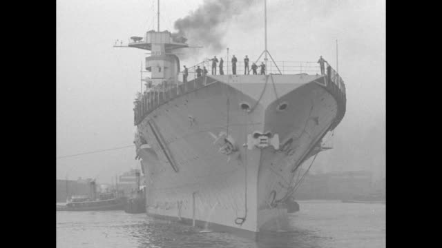saratoga starboard bow and port some men on deck / vs tugboats tow uss saratoga / ls tugboats tow uss saratoga us flag waves in foreground / ms... - dry dock stock videos & royalty-free footage