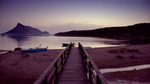 sardinian beach at dawn - spiaggia stock videos & royalty-free footage