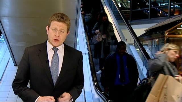 sarkozy criticises brown's economic policy of cutting vat int reporter to camera with speeded up shots of shoppers on escalator beside - vat stock videos & royalty-free footage