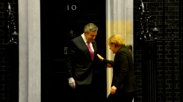 Sarkozy criticises Brown's economic policy of cutting VAT R30100808 MOTION of Brown greeting Angela Merkel and posing for photocall on doorstep of...
