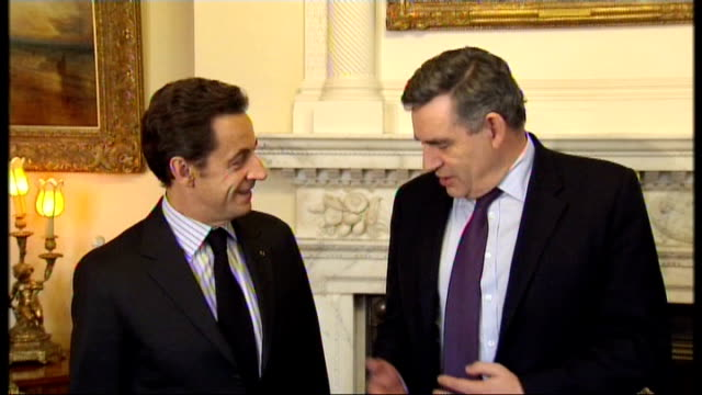 sarkozy criticises brown's economic policy of cutting vat t08120836 london downing street brown and sarkozy posing for photocall **flash photography** - vat stock videos & royalty-free footage