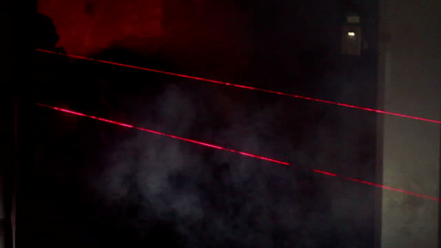 sas or swat team enter smokey building in dark with lasers on their automatic weapons and guns NO