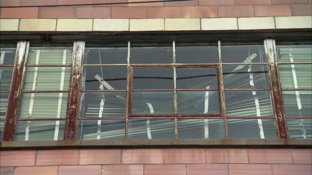 cu la sash windows of dilapidated industrial building / rutland, vermont, usa - sash window stock videos and b-roll footage
